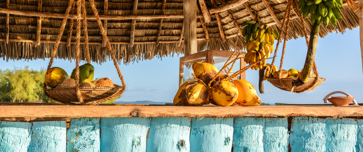 shutterstock_263291978_In the picture beach bar in Nungwi ( Zanzibar ) at sunset , with exposed coconut , banana and tropical fruit.